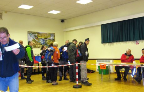 Walkers waiting for kit check at start of event